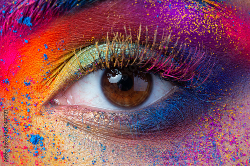 Leinwanddruck Bild Close up view of female eye with bright multicolored fashion makeup. Holi indian color festival inspired. Studio macro shot