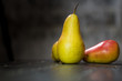 Group of ripe pears on dark rustic wooden table. Side view horizontal shot. Empty copyspace for your design. - 243445115