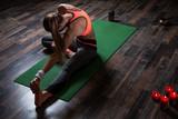 Long haired woman bending her back while doing yoga asana - 243448347