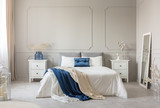 Stylish white, grey and petrol blue bedroom design, copy space on empty wall - 243453140