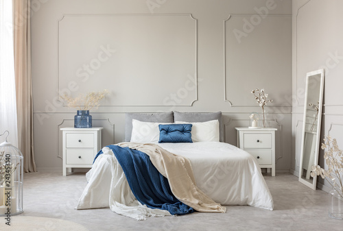 Stylish white, grey and petrol blue bedroom design, copy space on empty wall © Photographee.eu