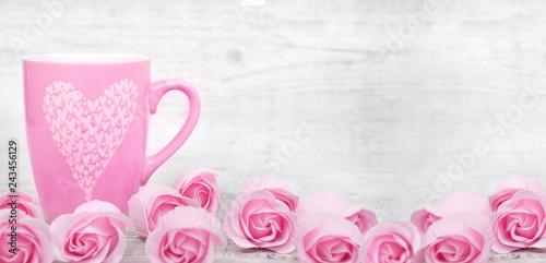 Leinwandbild Motiv Pink porcelain coffee cup and pink heart roses