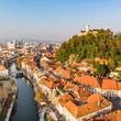 Leinwandbild Motiv Aerial panoramic view of Ljubljana, capital of Slovenia in warm afternoon sun.