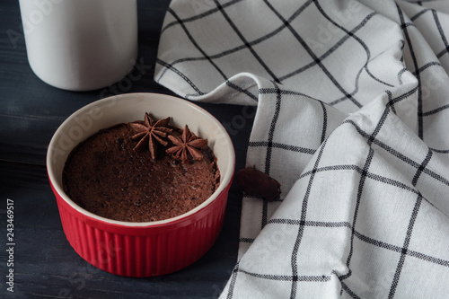 Chocolate fondant, lava cake with berries and cocoa beans on dark background,  close up