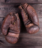 very old brown boxing gloves - 243472185