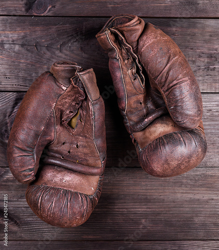 very old brown boxing gloves