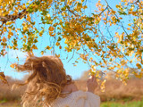 Beautiful pregnant woman on nature under the birch leaves. Beautiful pregnant woman in a white woolen sweater. - 243474314