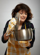 Housewife holding a pot
