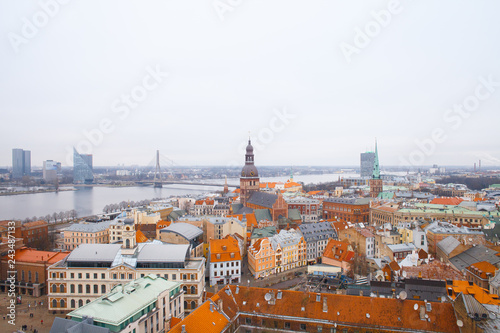 Fridge magnet Beautiful aerial view of the old town Riga. View of the roofs of the old town from above. Winter season in Riga, Latvia