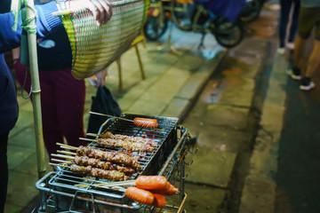 Vietnamese barbeque street food. Night market in Hanoi at night