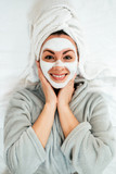 Portrait of a smiling young woman with face mask. - 243505195
