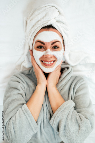 Portrait of a smiling young woman with face mask.