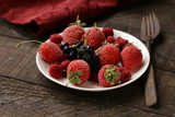 fresh organic berries for breakfast on a plate - 243507500