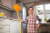 girl mops the floor at home - 243515535