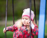Little cute girl walking in summer park, outdoor