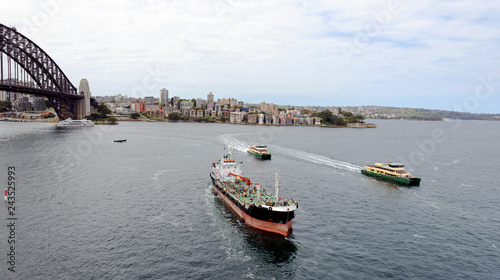 Passenger ferries and fuel ship heading across Sydney Harbor to Circular Quay in Sydney, Nes South Wales, Australia