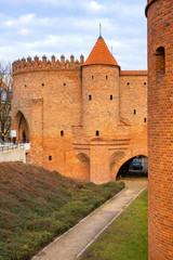 Warsaw, Poland - The Barbican - semicircular fortified XVI century outpost with the defense walls and fortifications of the historic old town quarter in Warsaw
