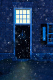 Old front door with illuminated upper window during snowfall. - 243528729