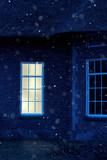 Illuminated window at dusk during snowstorm. - 243528732