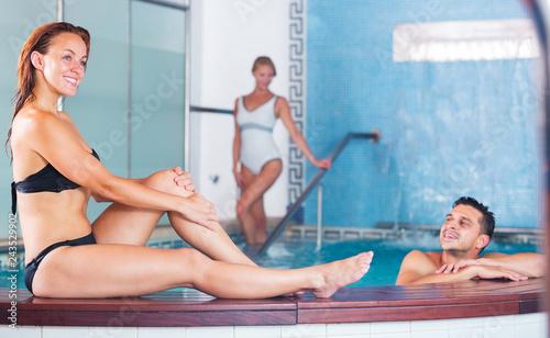 Girl posing in pool