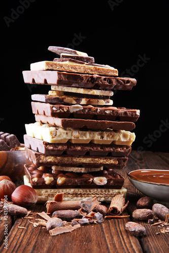 Leinwandbild Motiv Chocolate bars on table with chocolate tower.