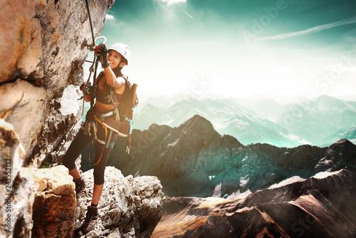Girl climbing on a Via Ferrata
