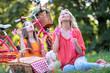 Leinwandbild Motiv Family having picnic in summer park