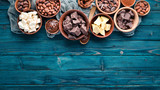 Chocolate, cocoa and cocoa beans on a blue wooden background. Top view. Free copy space. - 243558715