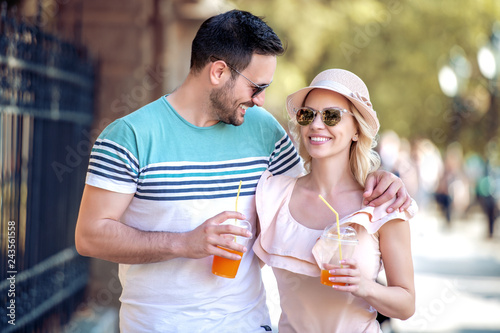 Young couple drinking healthy juice