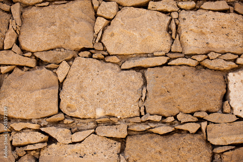 Pattern of the structure of a brick wall . Old wall European home - 243572599