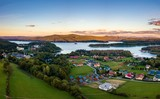 Sunset over Solina lake and Polanczyk village in Bieszczady mountains