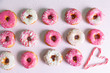Sweet and colourful donuts with sprinkles and frosting
