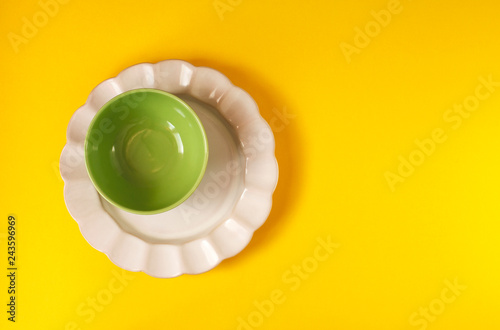 Two plates on yellow background