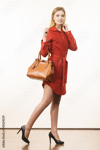 Fashion woman with leather handbag