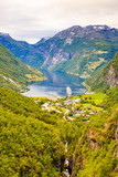 Fjord Geirangerfjord with ferry boat, Norway. - 243625166