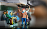 Miniature toy of people travelling on a public transport concept with shallow depth of field - travel on a train or bus. - 243627121