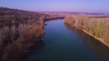 Slow drone flight over blue river and agricultural lands. Dniester river, Moldova republic of. 4K birds eye view - 243636934