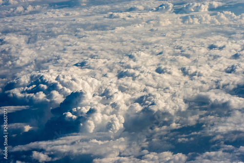 Flying Above the Clouds - View From the Airplane - 243637177