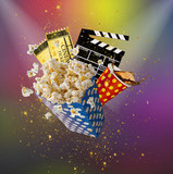 Pop-corn, movie tickets, clapperboard and other things in motion. - 243637321