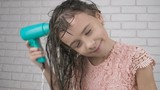 Child with a hairdryer. - 243637944