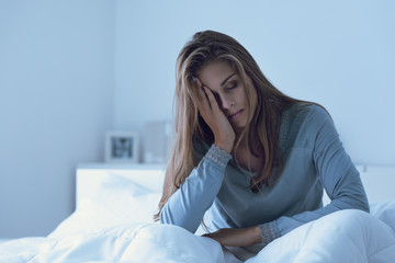Depressed woman awake in the night