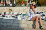 The woman tourist is visiting a small Croatian town Hvar. - 243648525