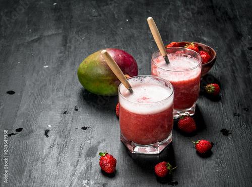 Leinwandbild Motiv Berry smoothie with fruit.