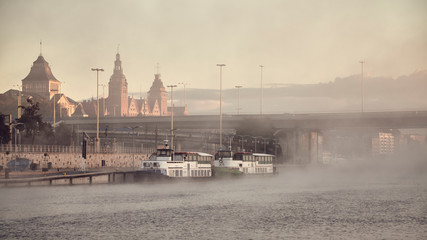 Szczecin City waterfront on foggy morning, color toning applied, Poland.