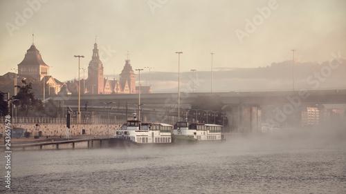 Zdjęcia na płótnie, fototapety na wymiar, obrazy na ścianę : Szczecin City waterfront on foggy morning, color toning applied, Poland.