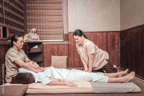 Beautiful young woman visiting Thai massage salon
