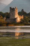Ross castle in killarney national park reflected in the lake at sunset - 243684544