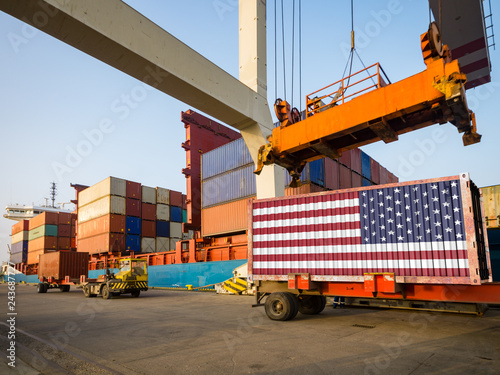 american container with usa flag in port. concept of american import and export.3D render
