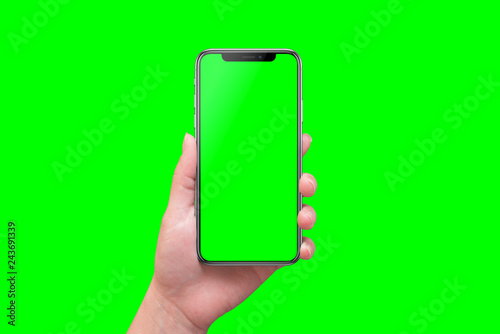 Modern smart phone in hand close-up. Isolated screen and background in green. - 243691339