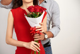 Cropped image of boyfriend presenting bouquet of flowers - 243692908